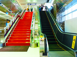 Take the escalator from the second floor to the first floor